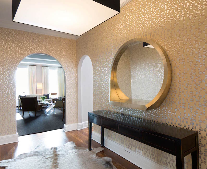 Gold wall foyer design