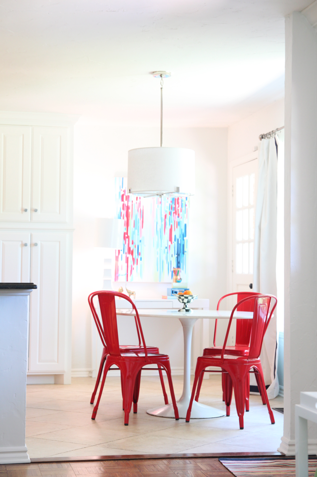 red metal chairs white table modern kitchen
