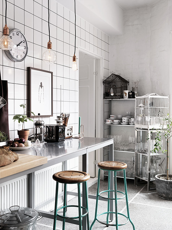 white tile kitchen with stainless steel table
