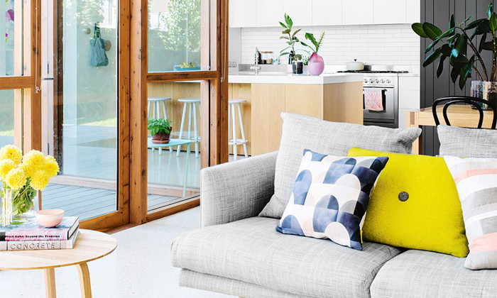 gray sofa & yellow cushions