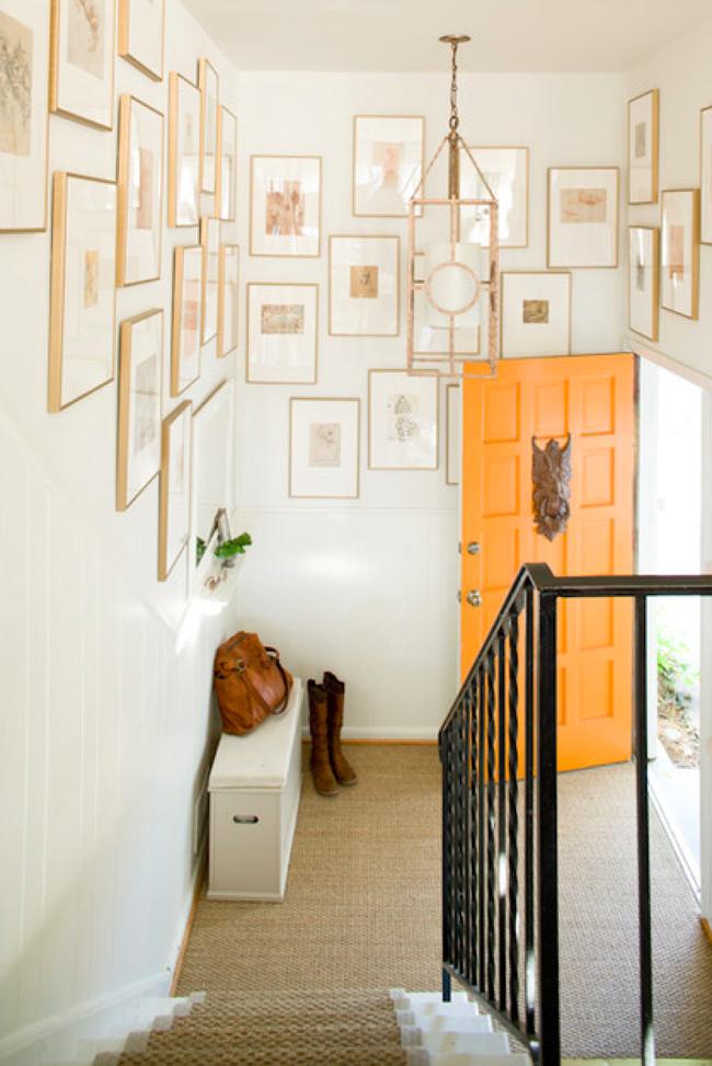 orange front door gallery wall entrance